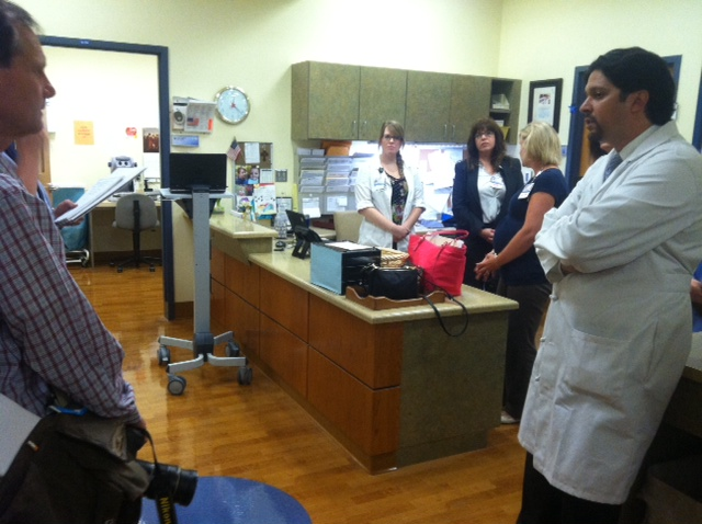 Dr. Amit Tevar, right, discusses the new UPMC Altoona transplant clinic with the media.