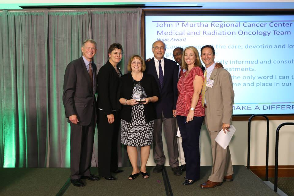 Peter G. Ellis, M.D., deputy director of Clinical Services, UPMC CancerCenter and Stephanie K. Dutton, Chief Operating Officer, UPMC CancerCenter, present the Hope Award to the John F. Murtha Regional Cancer Center Medical and Radiation Oncology Team.