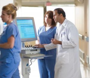 Dr. Humar with staff around C.O.W.